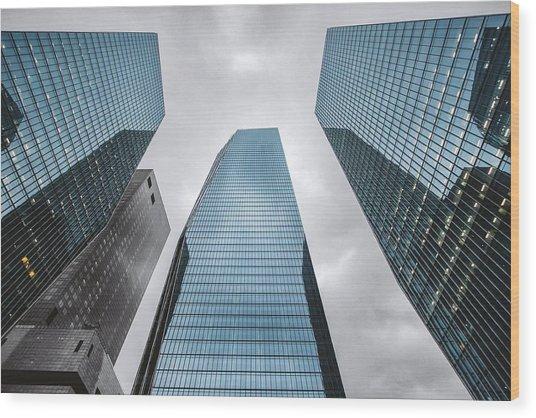 Low Angle View Of Modern Buildings Wood Print by Oliver Byunggyu Woo / Eyeem