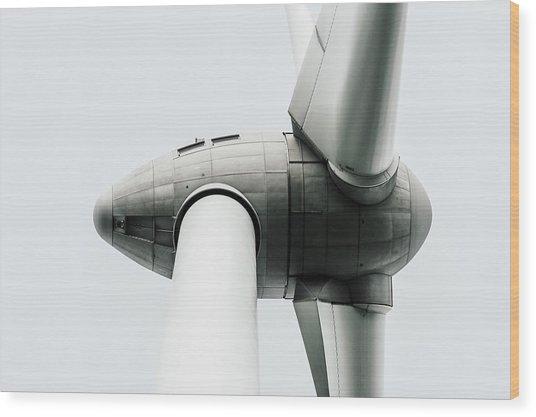 Low Angle View Of Wind Turbine Against Sky Wood Print by Michael Moeller / EyeEm