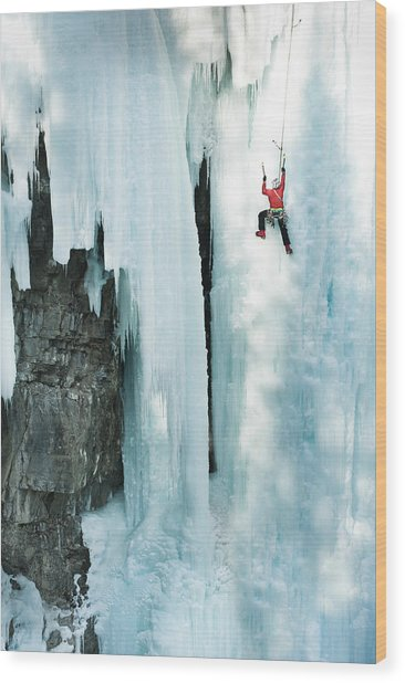 Male Ice Climber Scales Big Ice-covered Wood Print
