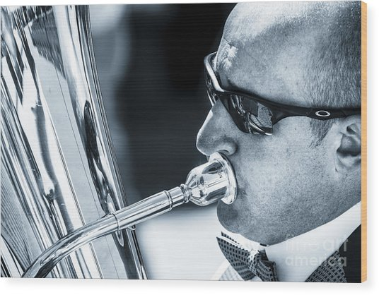 Male In Sunglasses Blowing Mouthpiece Of Tuba Wood Print