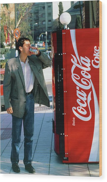 Man Drinking A Can Of Coke Wood Print by Marcelo Brodsky/science Photo Library