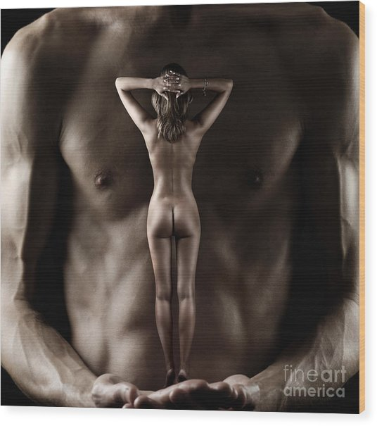 Man Holding A Naked Fitness Woman In His Hands Wood Print