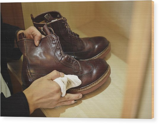 Man Polishing Leather Shoes Wood Print by Yagi Studio