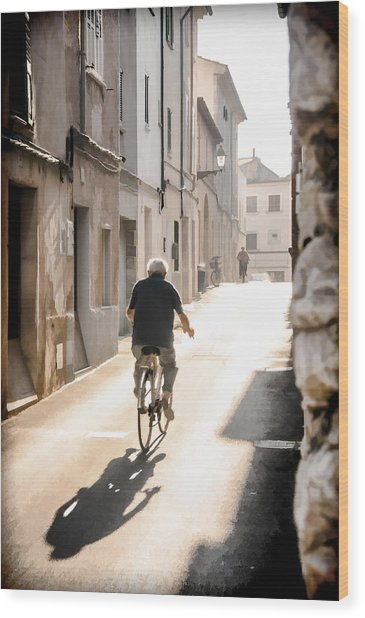 Man Riding Bicycle In Street In Puerto Pollenca Wood Print