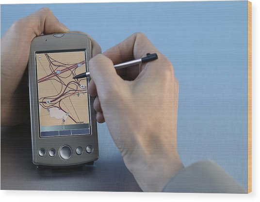 Man Using Gps System Wood Print by Comstock