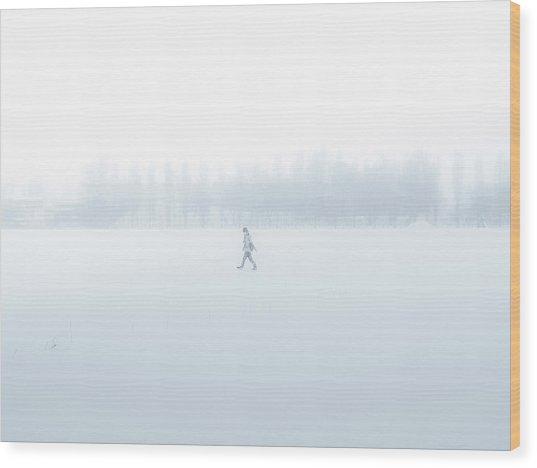 Man Walking Through A Snowfield Wood Print by Taketan