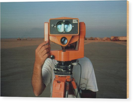 Man With A Survey Instrument In The Libyan Dessert Wood Print by Joe Pasieka/science Photo Library