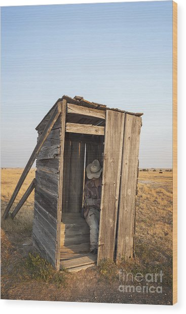 Mannequin Sitting In Old Wooden Outhouse Wood Print