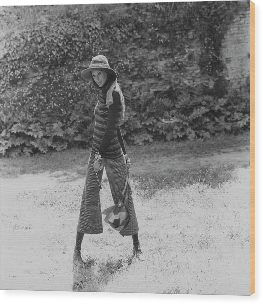 Marisa Berenson Wearing A Sweater And Pants Wood Print