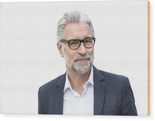 Mature Grey-haired Man In Suit Smiling Wood Print by Robin Skjoldborg