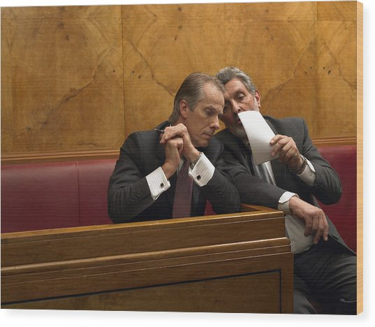 Mature Man Whispering To Colleague In Pew Wood Print by Michael Blann