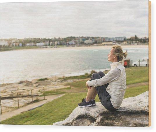 Mature Woman Enjoying The Ocean View Sydney Australia Wood Print by OwenPrice