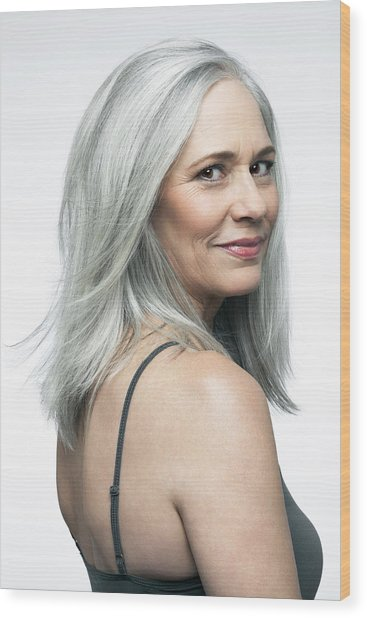 Mature Woman With Grey Hair In A 3/4 Position. Wood Print by Andreas Kuehn