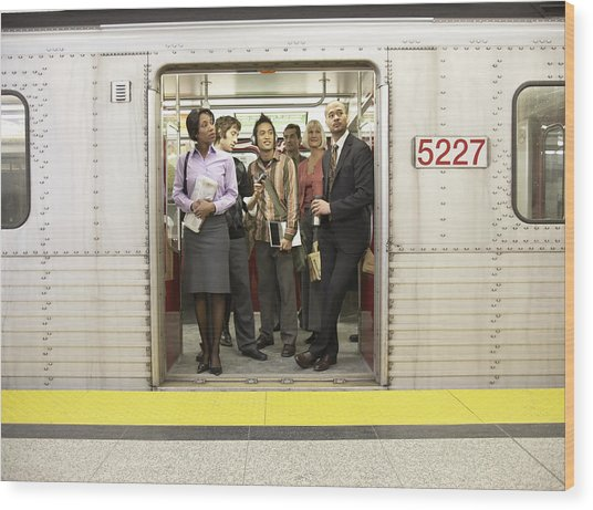 Medium Group Of People Standing In Subway Train Doorway Wood Print by Darrin Klimek