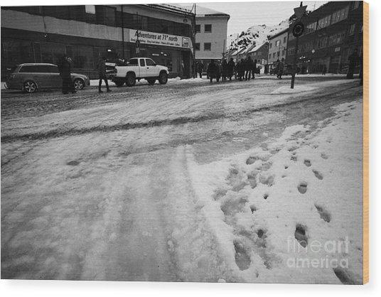 melting ice and snow on street surface holmen Honningsvag finnmark norway europe Wood Print by Joe Fox