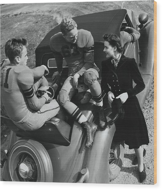 Model By Football Players On A Car Wood Print