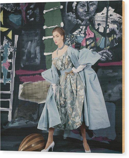 Model In Paper Taffeta Dress Wood Print by Henry Clarke