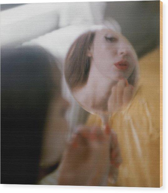 Model Looking In Hand Mirror While Preparing Wood Print