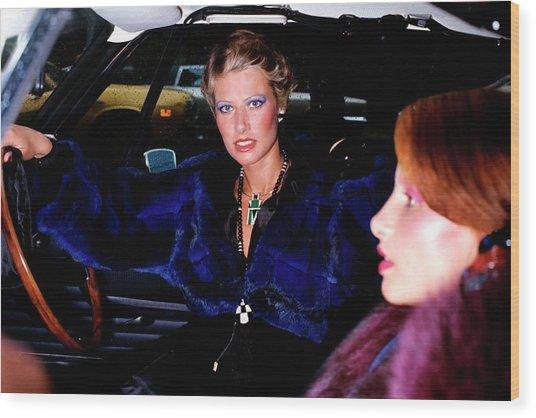 Model Wearing A Blue Chinchilla Jacket In A Car Wood Print