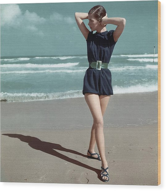 Model Wearing A Blue Swimsuit On A Beach Wood Print