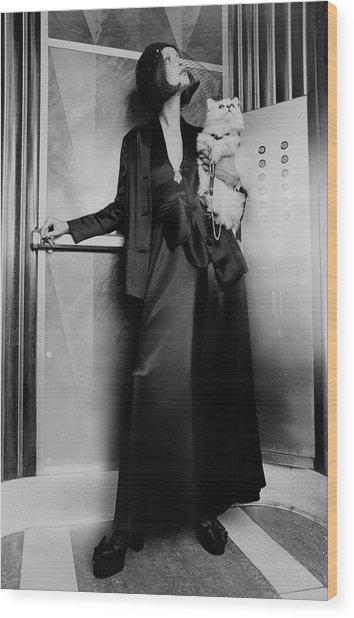 Model Wearing A Larry Aldrich Pantsuit Holding Wood Print