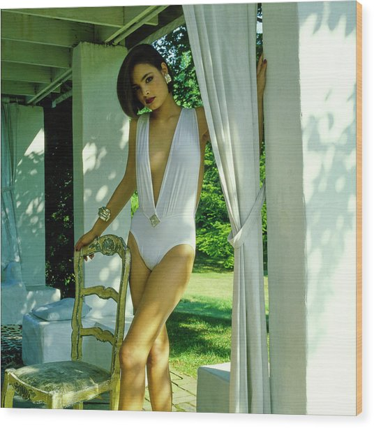 Model Wearing A White Swimsuit Wood Print