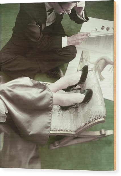 Model Wearing Velvet Pumps With A Man Sitting Wood Print by Frances McLaughlin-Gill