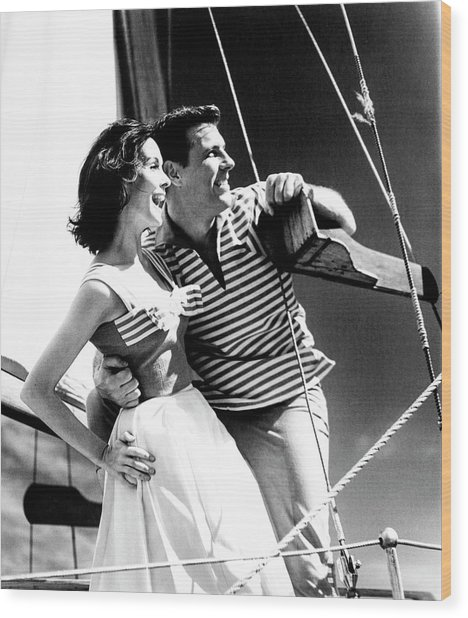 Models On A Sailboat Wood Print by Richard Waite