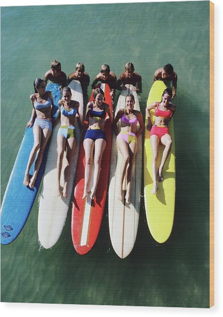 Models Wearing Bikinis Lying On Surfboards Wood Print