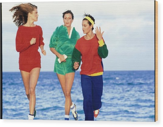 Models Wearing Sportswear On A Beach Wood Print