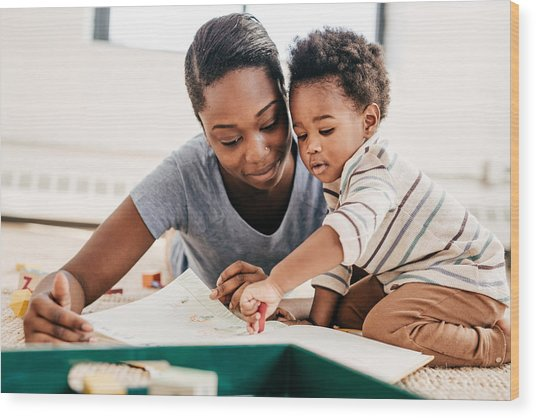 Mom Reading For Toddler Wood Print by Weekend Images Inc.