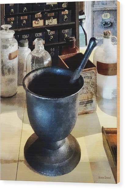 Mortar And Pestle Near Medicine Bottles Wood Print by Susan Savad