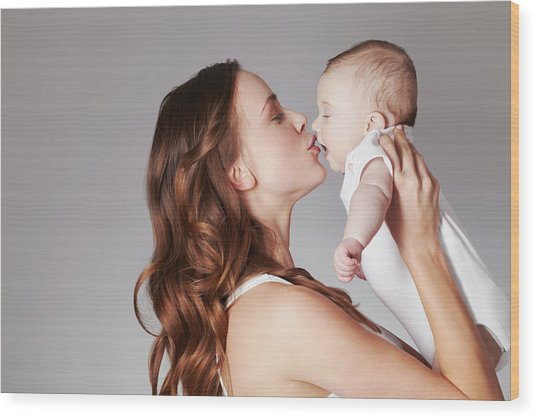 Mother Kissing Baby Daughter Wood Print by Emma Kim