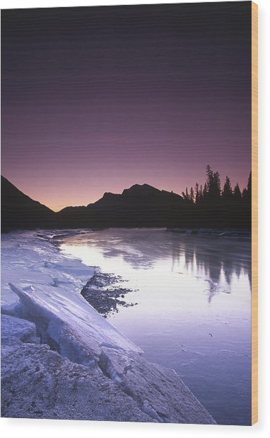 Mount Mcgillvary Silhouetted Behind An Icy Bow River Wood Print by Richard Berry