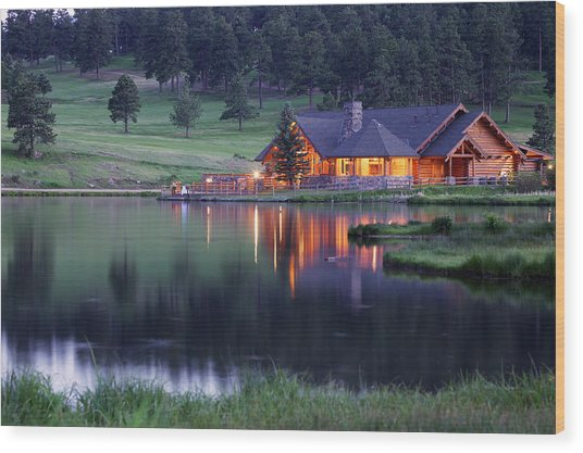 Mountain Lodge Reflecting In Lake At Wood Print by Beklaus