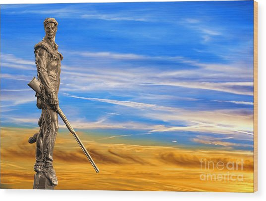 Mountaineer Statue With Blue Gold Sky Wood Print