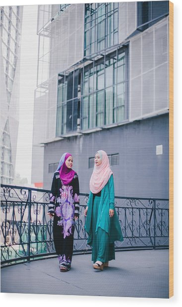 Muslim Women In Hijab In Discussion Wood Print by Mikhaella Ismail