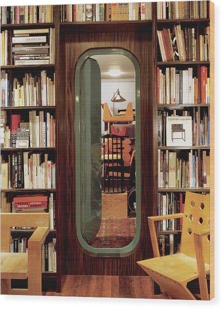 Neatly Arranged Bookshelf Wood Print
