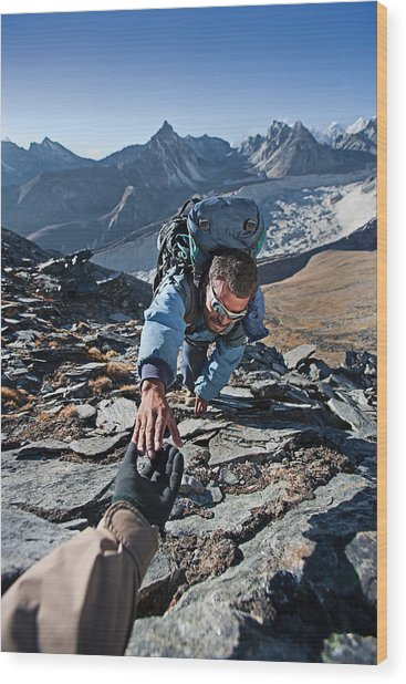 Nepali Sherpa Climbing In Himalayas Wood Print by Hadynyah