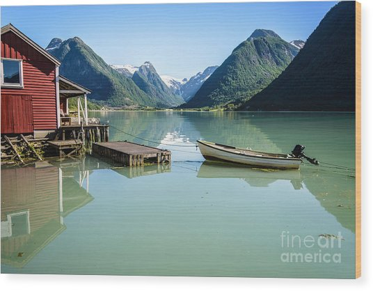 Reflection Of A Boat And A Boathouse In A Fjord In Norway Wood Print