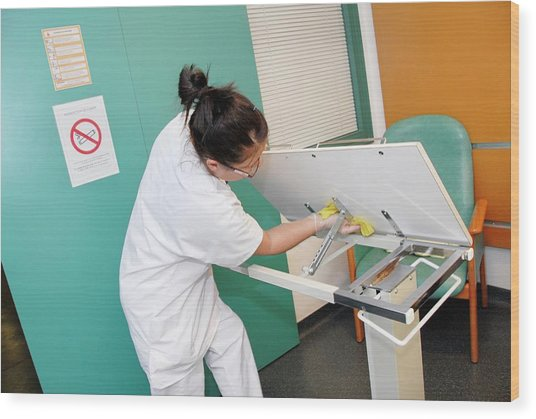 Nurse Cleaning Hospital Table Wood Print by Aj Photo/science Photo Library