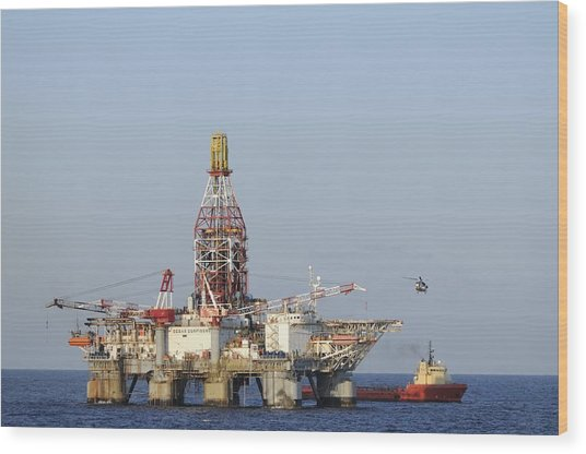 Off Shore Oil Rig With Helicopter And Boat Wood Print