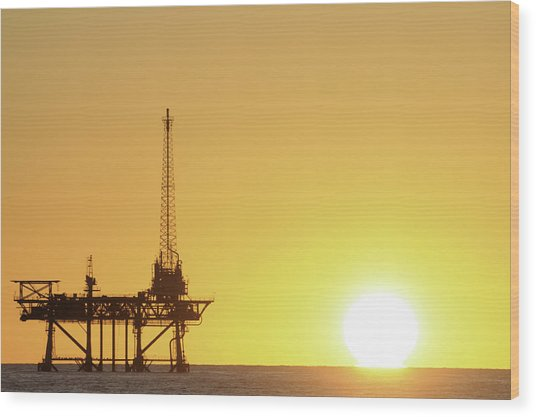 Offshore Oil Rig And Sun Wood Print