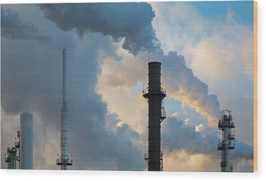 Oil Refinery Towers Wood Print by Jim West