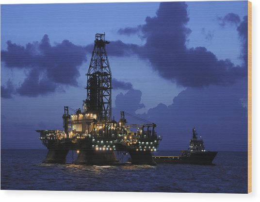 Oil Rig And Vessel At Night Wood Print