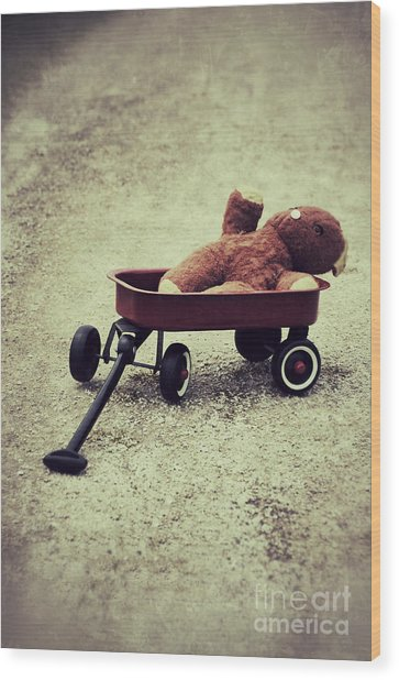 Old Teddy Bear In Red Wagon Wood Print