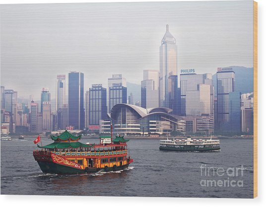 Old Traditional Chinese Junk In Front Of Hong Kong Skyline Wood Print by Lars Ruecker