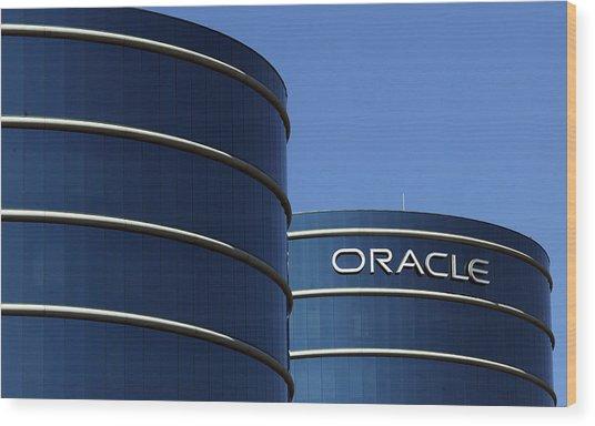 Oracle Makes Hostile Bid For Rival Peoplesoft Wood Print by Justin Sullivan