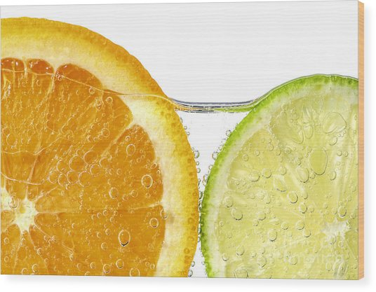 Orange And Lime Slices In Water Wood Print