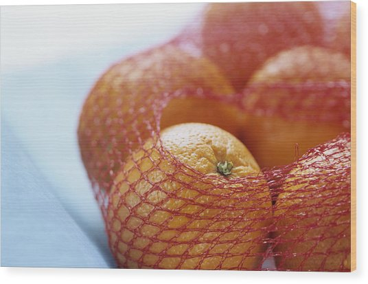 Oranges In Net, Close Up Wood Print by Achim Sass